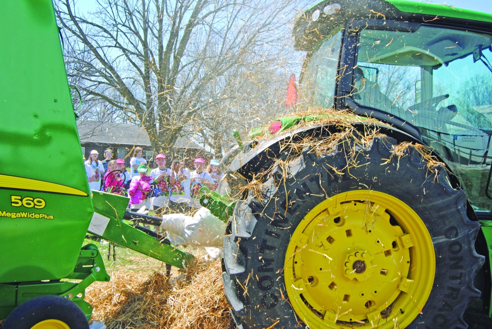 Students react and watch on as hay flies Friday, April 11, 2014, after a stuffed dummy was pulled into farm equipment during a safety demonstration at the McDonough County 4-H grounds. It was part of Progressive Agriculture Safety Day, an annual outing for students that entailed an array of activities in 15 areas, including several farming-related safety or informational demonstrations, as well as talks over first aid, water and utility safety, and a rollover demonstration. Activities were attended by kids from Macomb, Bushnell-Prairie City, West Prairie, St. Paul and Abingdon.