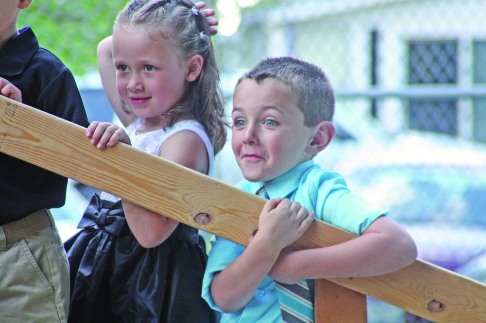 Five-year-olds Kyra and Timmy look out into the park after their time on stage during the third annual Little Miss and Master Good Hope Pageant Friday, June 6, 2014. The village's pageant was among the first events to kick off the 40th annual Good Hope Sodbuster Days.